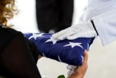 29727384-active-navy-representatives-giving-the-us-flag-to-the-widow-at-a-veterans-funeral[1]
