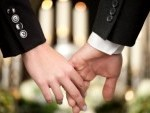 13712561-religion-death-and-dolor--couple-at-funeral-holding-hands-consoling-each-other-in-view-of-the-loss[1]
